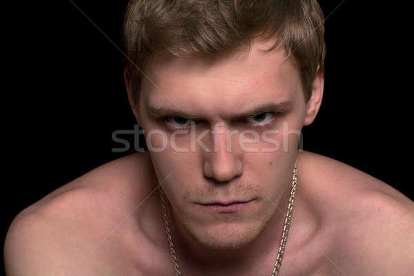 Foto stock: Retrato · enojado · joven · primer · plano · aislado · negro