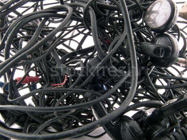 Interlacing of the broken off wires of old headphones. backgroun Stock photo © acidgrey