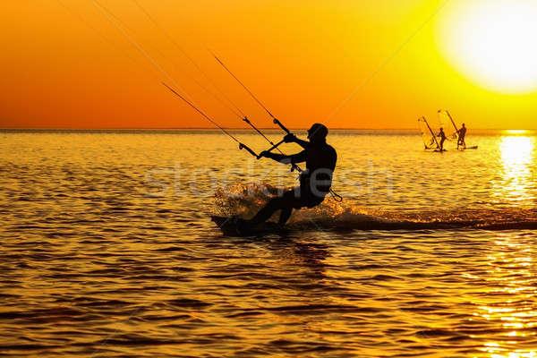 Silhouettes of a windsurfers Stock photo © acidgrey
