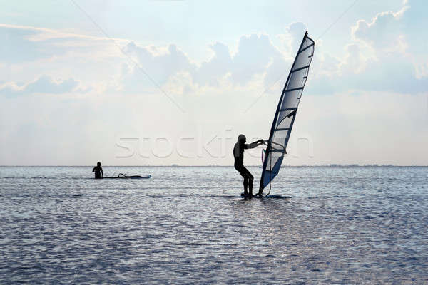 Silhouette of a windsurfer Stock photo © acidgrey