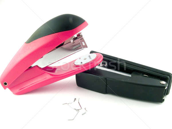 Red and black staplers on a white background. isolated Stock photo © acidgrey