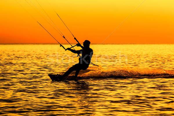 Silhouet zeilen zee zonsondergang water licht Stockfoto © acidgrey