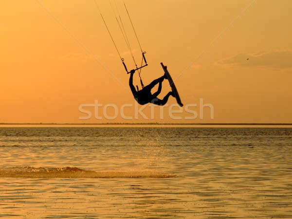 Silhouette of a kitesurf, a flying above water of a gulf Stock photo © acidgrey