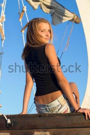 woman wearing union-flag shirt and holding umbrella Stock photo © acidgrey