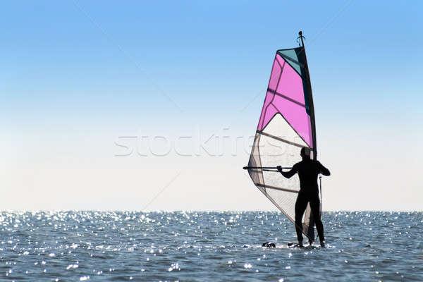 Silhouette of a woman windsurfer Stock photo © acidgrey