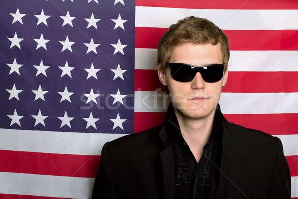 Młody człowiek okulary amerykańską flagę człowiek biznesmen banderą Zdjęcia stock © acidgrey