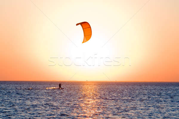 Silhouette of a kitesurfer on a gulf on a sunset Stock photo © acidgrey