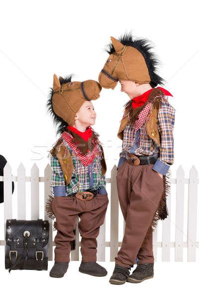 Dos ninos caballo aislado Foto stock © acidgrey