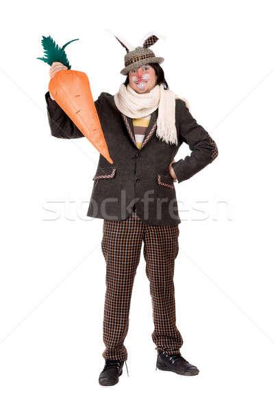 Giovane carota suit coniglio mano party Foto d'archivio © acidgrey