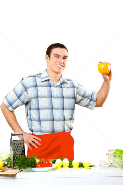 portrait of a young man, hold bell pepper Stock photo © adam121