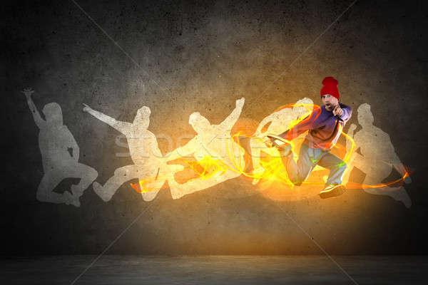 Hip hop táncos fiatal ugrás sziluettek szürke Stock fotó © adam121