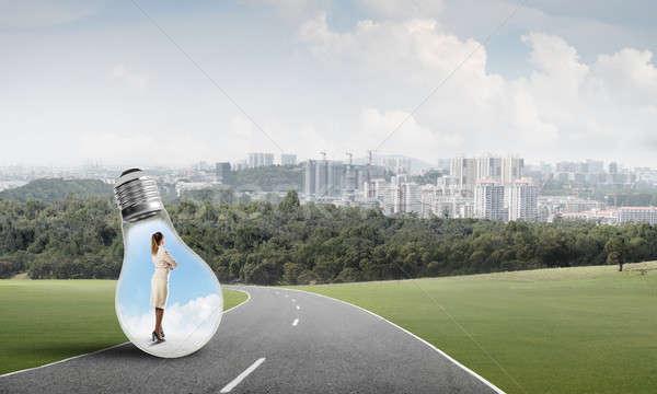 Stock photo: Businesswoman inside light bulb