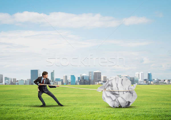 Człowiek wysiłek duży piłka papieru Zdjęcia stock © adam121