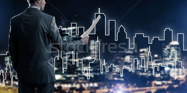 Man architect or engineer presenting construction concept and ho Stock photo © adam121