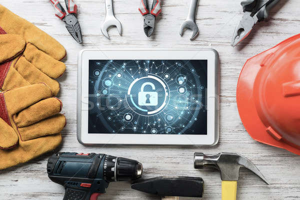 Web security and technology concept with tablet pc on wooden tab Stock photo © adam121
