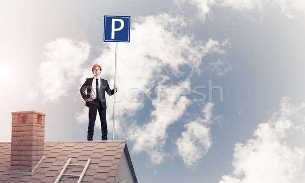 Jóvenes empresario aparcamiento signo pie ladrillo Foto stock © adam121