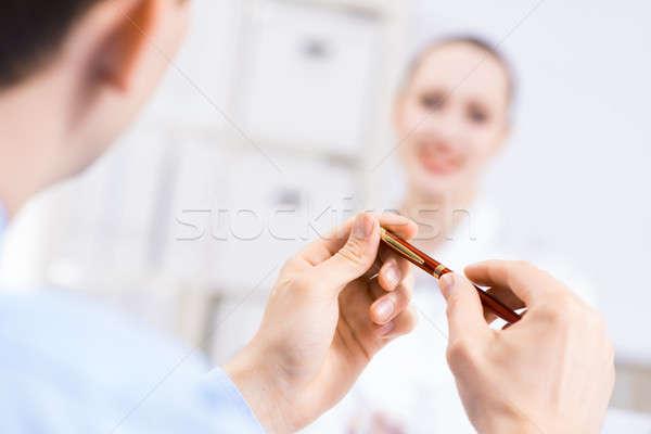 Mãos caneta brilhante jovem Foto stock © adam121