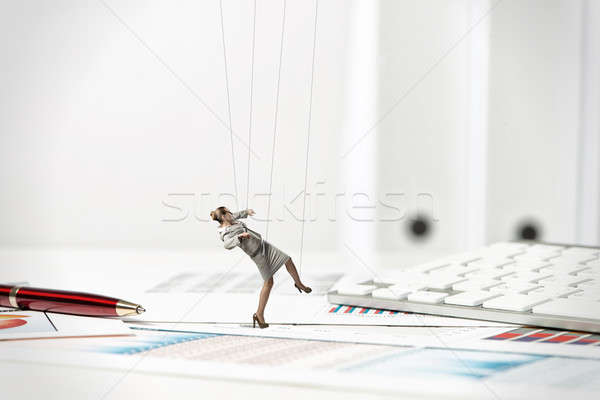 businesswoman puppet doll is on the desk Stock photo © adam121