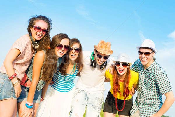 Grupy młodych ludzi okulary hat Zdjęcia stock © adam121