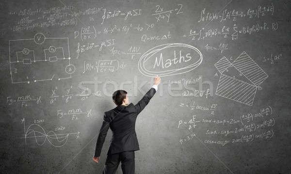 Man writing on blackboard Stock photo © adam121