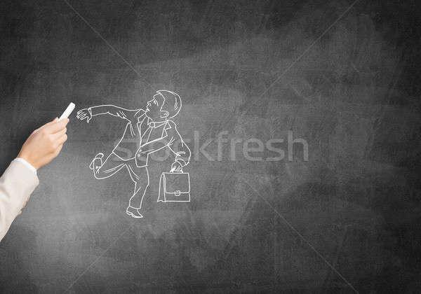 Ejecutando empresario femenino mano dibujo tiza Foto stock © adam121
