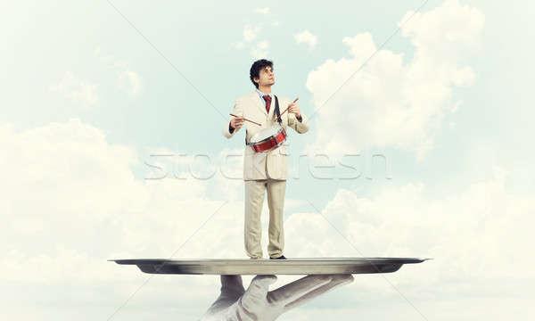Jonge zakenman metaal dienblad spelen drums Stockfoto © adam121
