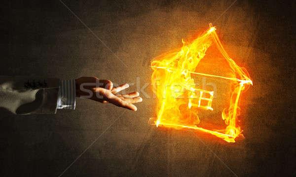 Businessman hand pointing at burning fire symbol Stock photo © adam121