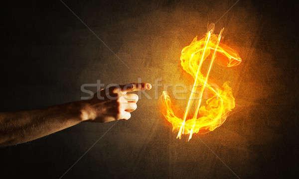 Soldi dollaro valuta fuoco simbolo Foto d'archivio © adam121