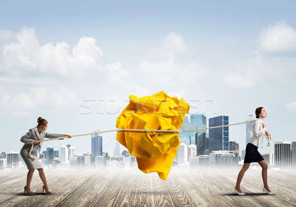 Deux femmes effort grand balle papier Photo stock © adam121