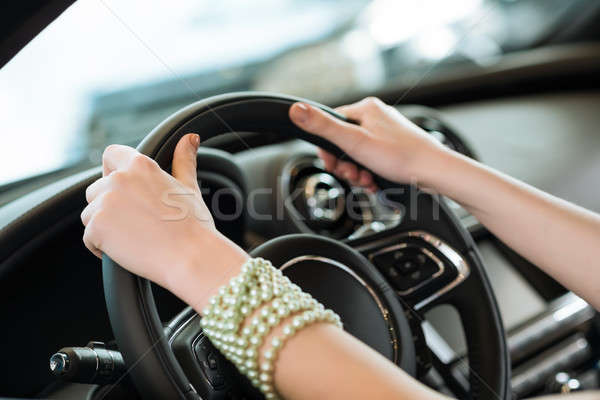 woman's hands holding on to the wheel of a new car Stock photo © adam121