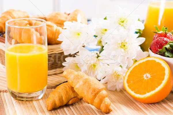 рано завтрак апельсиновый сок круассаны клубники натюрморт Сток-фото © adam121
