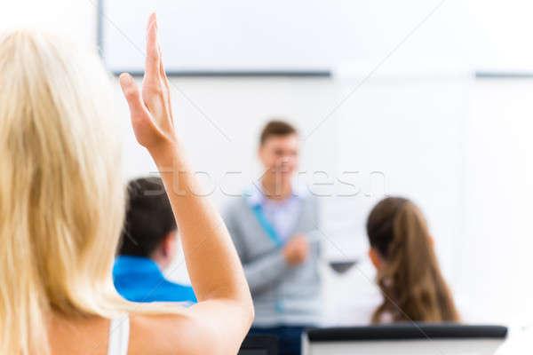 female hand raised in class Stock photo © adam121