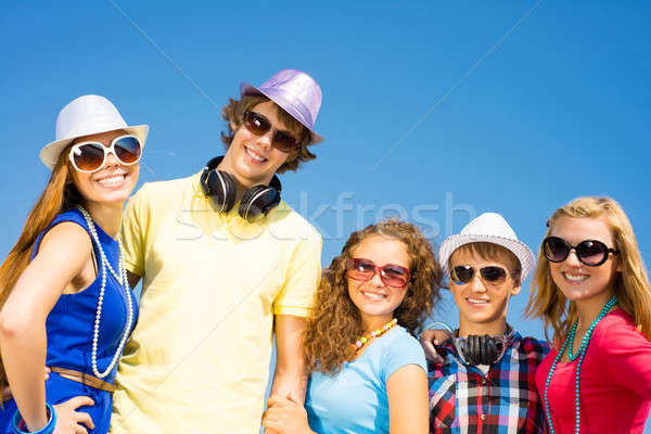 group of young people wearing sunglasses and hat Stock photo © adam121