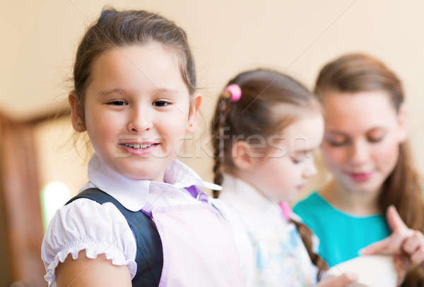Portrait of Asian girl in apron painting Stock photo © adam121