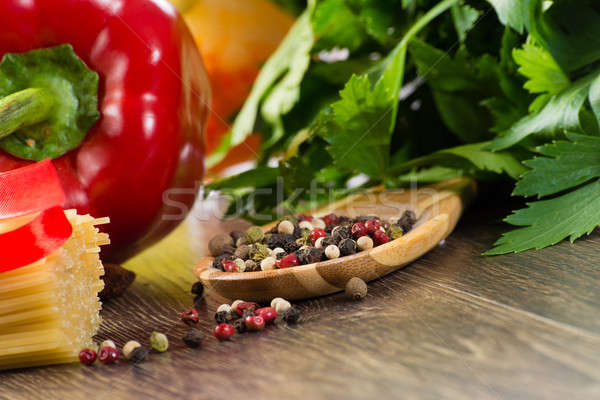 close-up of colored pepper on wooden spoon Stock photo © adam121