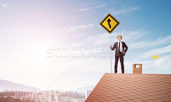 Senhor patrão tijolo telhado assinar mãos Foto stock © adam121
