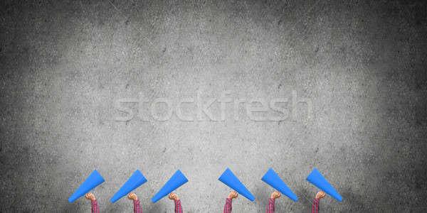 çok eller kadın kâğıt trompet Stok fotoğraf © adam121