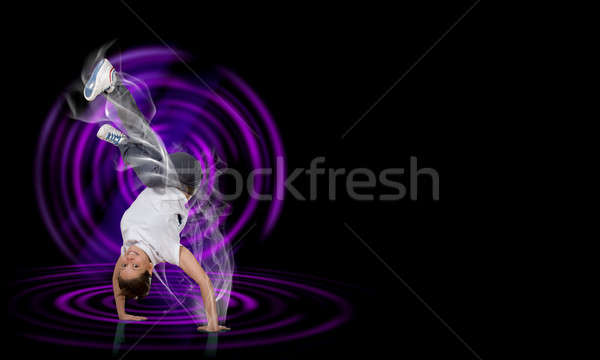 Breakdancer standing on hand Stock photo © adam121
