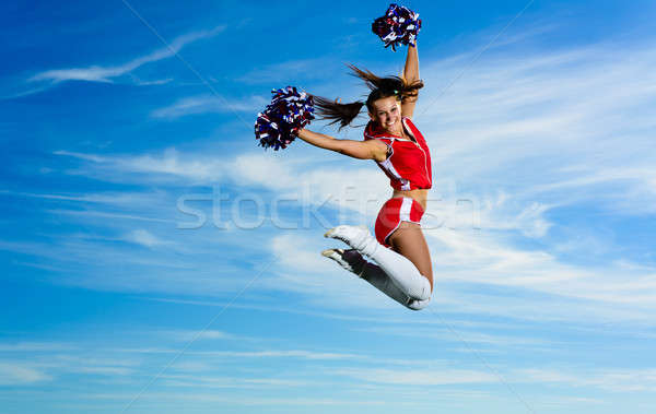 Young cheerleader in red costume jumping Stock photo © adam121