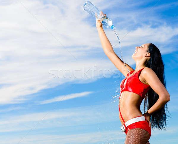 Sportu dziewczyna czerwony uniform butelki wody Zdjęcia stock © adam121