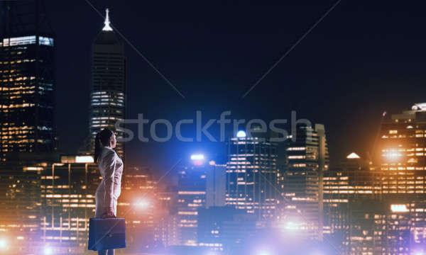 женщину глядя ночь город вид сзади элегантный Сток-фото © adam121