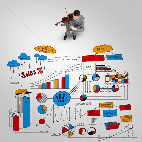 Biznesmen grać sukces melodia górę widoku Zdjęcia stock © adam121