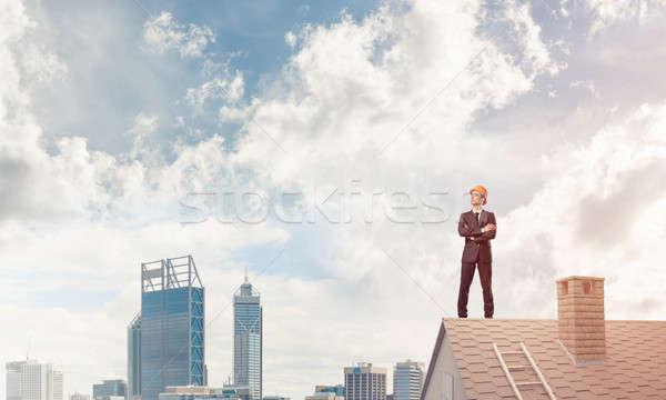 Ingénieur homme permanent toit mixte Photo stock © adam121