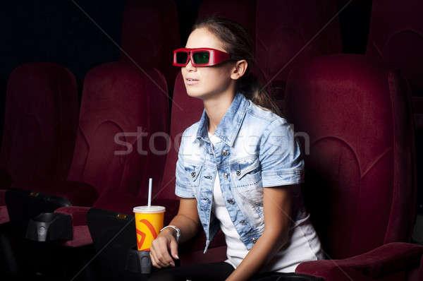 Kobieta kina młoda kobieta posiedzenia sam oglądania Zdjęcia stock © adam121