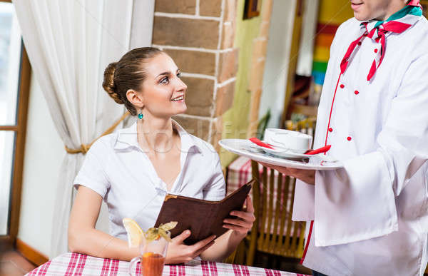 waiter brings a dish for a nice woman Stock photo © adam121