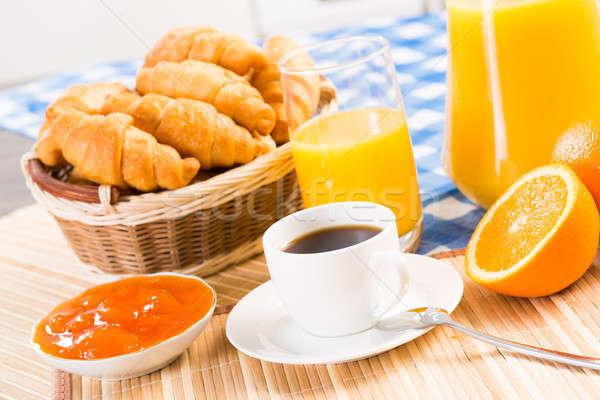Континентальный завтрак кофе апельсиновый сок круассаны натюрморт фрукты Сток-фото © adam121