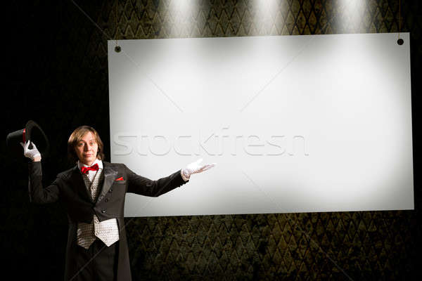 magician in top hat and tie points to the banner Stock photo © adam121