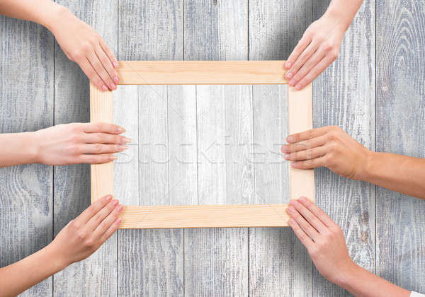 Stock photo: Hands holding frame