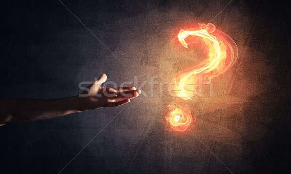 Concept of help or support with fire burning question mark and c Stock photo © adam121