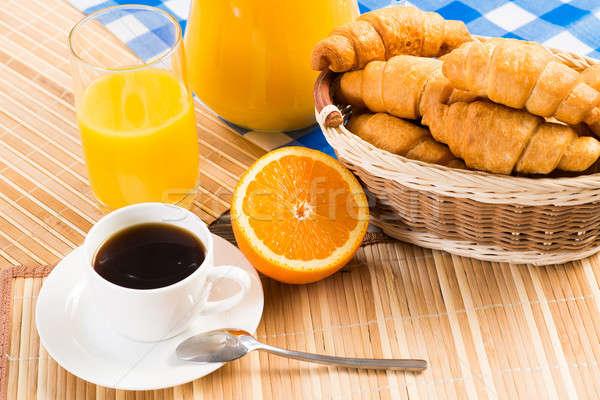 Colazione continentale caffè arancione cornetto succo frutta Foto d'archivio © adam121